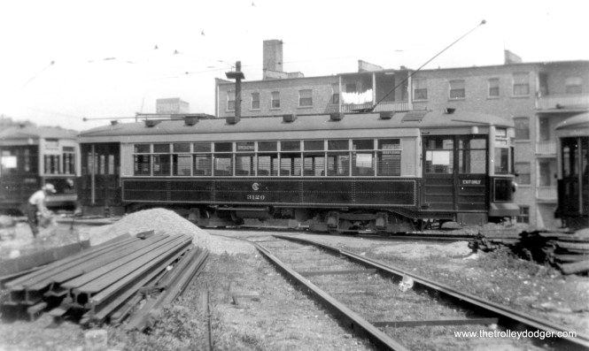 "George Trapp: ""Car 3120 and others of it's class are actually in the Clark-Arthur loop, materials stockpiled for rebuilding of Devon Depot which was being rebuilt at the time."" Half of Devon Station burned down in a 1922 fire. (Fred Borchert Photo, printed by Edward Frank, Jr.)"
