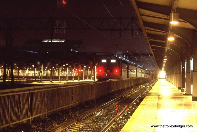 A NJ Transit ALP-44 along side the terminal's Bush train shed.3/30/02