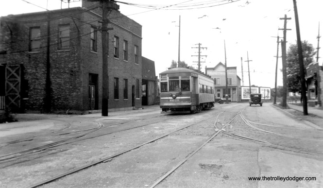 We previously ran another version of this photograph in our post Chicago Streetcars in Black-and-White, Part 3 (March 29, 2015), although that version was cropped somewhat. There, the caption read as follows: CSL 6200 by Hammond Station (car house), 1939. According to Andre Kristopans, this street is called Gostlin. (M.D. McCarter Collection)