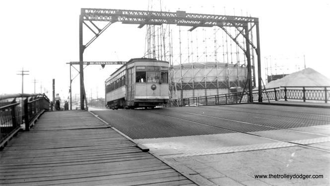 """This is a higher-res version of a photo that originally appeared in our post The """"Other"""" Penn Central (May 29, 2016). Bob Lalich writes, """"The location of photo csl127 is East Chicago, IN. The road is Indianapolis Blvd and the bridge spans the west leg of the Indiana Harbor Canal. The car is SB."""""""