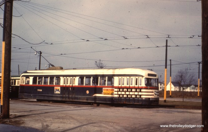 """CTA 7012 at the Narragansett Loop on the west end of route 63. Tony Waller adds, """"In image 257, the pre-war PCC must have been photographed in December 1951. All pre-war PCCs were removed from 63rd St. in Spring 1952 and rebuilt for one man operations (with elimination of one of the center doors). They were then assigned to Cottage Grove."""""""