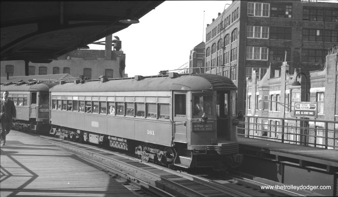 """It's the evening rush hour on June 3rd, 1959, and North Shore Line car 161 is on the tail end of a northbound train at Chicago Avenue on the """"L"""". (Bob Selle Photo)"""