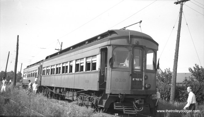 """Chicago, Aurora & Elgin wood car 318 under wire on a July 4, 1949 fantrip. The index card with this negative reads: Monitor roof double end steel interurban. Builder: Jewett 1909; Weight 100,000 lbs.; Motors 4 GE 66 HP 500; Seats 52; Length 54' Width 8' 8"""" Height 13' 6"""". On the same day, the New York-based Electric Railroader's Association held a Chicago fantrip on south side streetcar lines that were soon to be abandoned. You can see a picture from that trip in our post Chicago Surface Lines Photos, Part Five."""