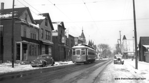 """CSL 2779 in a wintry scene, probably in the 1940s. The location is unknown, as the roll sign on the car simply reads """"Downtown."""" According to Don's Rail Photos, this car was part of a series known as Robertson Rebuilds, built by St. Louis Car Company in 1903. Don Ross: """"These cars were similar to 2501-2625 but were longer and heavier. They were built with McGuire 10-A trucks but were replaced with Brill 51-E-1 trucks in 1918. An additional 20 cars were ordered, 2781-2800, but they were delivered to St Louis & Suburban Ry as 600-619. It replaced most of their cars in a carbarn fire that destroyed most of their equipment."""" (Joe L. Diaz Photo) Michael Franklin: """"Headed south on Damen Ave with Roscoe St. in the distance."""""""