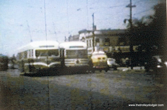 """This picture was taken at Madison and Austin, west end of route 20. Interstingly, two prewar CSL PCCs are posted side by side. That's 4018 in experimental paint at left, next to a car in """"tiger stripes."""" (John Marton Collection)"""
