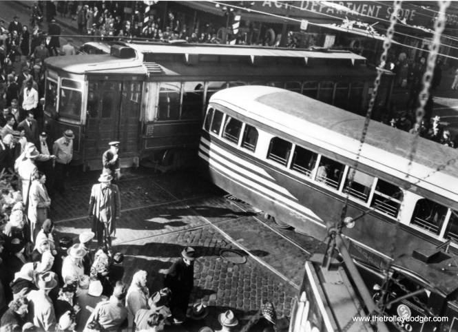 "On November 29, 1949 it was reported: ""At least 14 persons were reported injured, one critically, when two streetcars crashed at a busy intersection on the south side this afternoon. Several pedestrians were among the injured."" You can just barely see a CTA wrecker in the lower right corner of the picture. M. E. writes: ""The smashup dated 29 November 1949 is at 63rd and Halsted, looking northwest at the Ace department store. About that store, I remember it was rather dowdy and had no air conditioning. It had lots of ceiling fans instead. So it was hot in summer. On the southwest corner was an SS Kresge dime store. In the window was a doughnut-making machine, which was probably 15 feet long, most of which was a chute in which the donuts took shape. The price was 3 cents per doughnut. Kresge was predecessor to K-Mart. On the southeast corner were small stores, the largest of which was a Stineway drug store. Notice the spelling: Stineway rather than Steinway as in pianos. On the northeast corner was a big Sears department store, with a Hillman's grocery in the basement. I think I heard once that this Sears was the largest in Chicago other than the downtown Sears at State and Van Buren."""