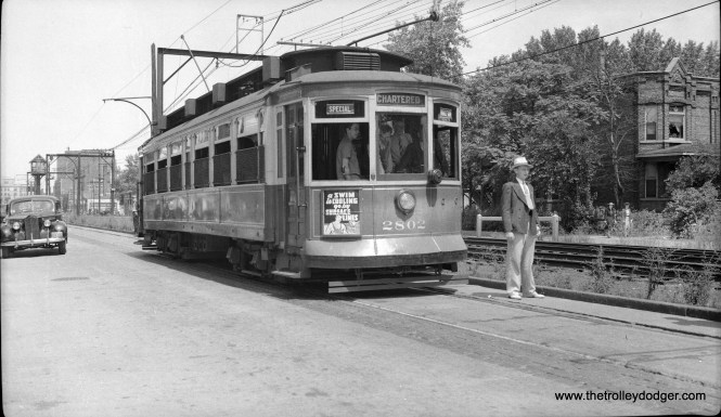 "Here is CSL 2802 on a July 13, 1941 CERA fantrip alongside the South Chicago branch of the Illinois Central Electric suburban service. That nattily dressed man has been identified as none other than George Krambles (1915-1998). We ran another picture from this trip in an earlier post Chicago Surface Lines Photos, Part Six (February 22, 2016). Known as a Robertson Rebuild, Don's Rail Photos says, ""2802 was built by St Louis Car Co in 1901 as CCRy 2554. It was sold as C&CS 702 in 1908 and renumbered 2802 in 1913. It became CSL 2802 in 1914."" A circa-1940 Packard prepares to go around the car. (Hochner Photo)"