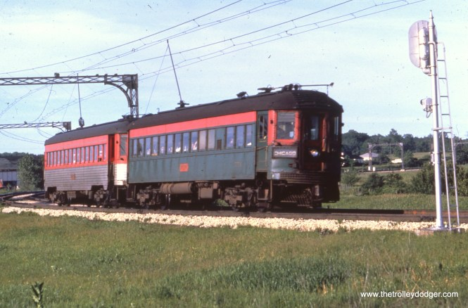 "NSL ""Greenliner"" 751 and a Silverliner at Lake Bluff in June 1962."