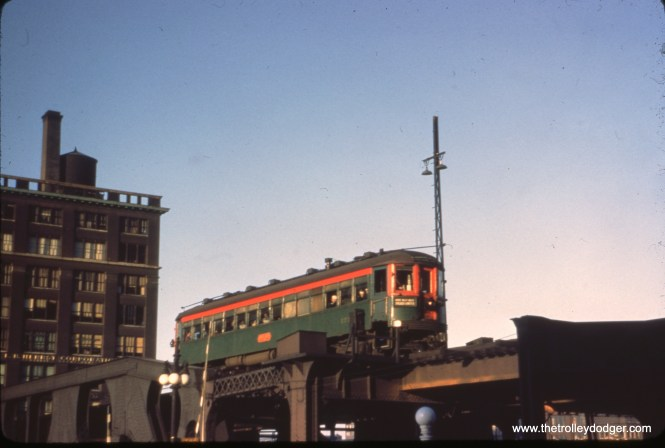 "A solitary North Shore Line car crosses the Chicago River at Wacker Drive on the ""L""."