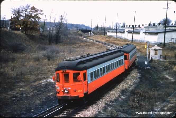 "CA&E 423 is part of a two-car train at Collingbourne. Nancy Grove Mollenkamp: ""Collingbourne is along the Elgin branch near Raymond St. and Elgin Ave."""