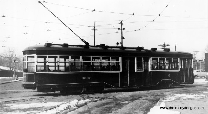 """CSL Sedan (Peter Witt) 3367 in service on the Cottage Grove route. Andre Kristopans: """"Sedan 3367 is turning west to north at 95th and Cottage Grove."""" M. E. writes, """"The photo titled """"CSL Sedan (Peter Witt) 3367 in service on the Cottage Grove route"""" must have been taken at 95th and Cottage Grove, because the streetcar is turning from one road to another. At 95th St. there were actually two Cottage Grove Aves.– one heading north along the west side of the Illinois Central main line, the other heading south along the east side of the IC main line. To connect from one Cottage Grove to the other (whether north- or southbound), the streetcars turned left onto 95th St., went under the IC, then turned right on the other Cottage Grove. As for which side of the IC this picture depicts, I believe it is the west side, because I recall a wall along the south side of 95th St. Ergo, this view is west on 95th and the streetcar is heading north."""" (Robert V. Mehlenbeck Photo, Joe L. Diaz Collection)"""