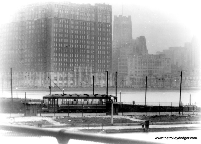 """I'm not sure of the exact location of this car at Chicago's lakefront. Is this Navy Pier? Oak Street beach? Or somewhere else entirely? Andre Kristopans: """"The lakefront shot is indeed Oak St, the Chicago Ave loop which was on the NORTH side of Grand about where the entrance to the water filtration plant now is."""" George Foelschow: """"The lakefront picture features the Furniture Mart at Lake Shore Drive at Erie Street, built in 1926 and the largest building in Chicago for a time. The tiny beach would be at Ohio Street. The Chicago Avenue line approached Navy Pier until the drive was """"improved"""", though I believe its tracks were separate from the Grand Avenue line."""" M. E. writes, """"The photo titled """"I'm not sure of the exact location of this car at Chicago's lakefront"""" is probably, as you surmise, at Navy Pier. There was a huge building on the west side of Lake Shore Drive, which I think was the Furniture Mart. That would have been only a block north of Grand Ave., where Navy Pier is. There were no streetcars anywhere near the Oak St. beach."""""""