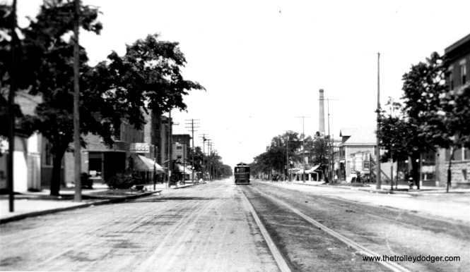 """One of our regular readers thinks this photo shows Evanston Avenue (now Broadway) between Devon and Lawrence. """"I believe that the streetcar is a Chicago Union Traction car, but it is too far away in the photo to identify. I believe that the view is looking north somewhere in Edgewater."""""""