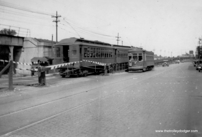 """There was a short stretch, less than half a mile actually, where Lake Street trains ran parallel under wire right next to streetcars, as you can see here. The trolley is heading west, while the train of wood cars is going east, and just starting to head up the ramp. Route 16 streetcars crossed the """"L"""" and turned north a block east of Central Avenue. (George Trapp Collection)"""