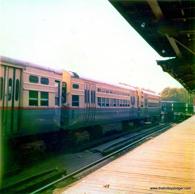 CTA 6151-6152, 17, and 18 at the Logan Square bumper post in 1959. The greenish blob in the lower left corner of the picture is lens flare caused by the sun, essentially internal reflections of the glass elements of the lens that occur when you shoot into the light. (Robert Geis Photo, George Trapp Collection)