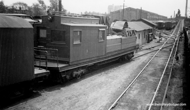 """CRT S-200 in the Lake and Hamlin yard. Don's Rail Photos says, """"S-200 was built by Barney & Smith in 1901 at M-WSER 783. It was renumbered in 1913 as 2783. In 1916 it was rebuilt as a work motor and numbered S-200. It became CRT S-200 in 1923."""" In this photo, it looks like it is being used to string trolley wire. You can see the ramp leading up to the """"L"""" at right. (George Trapp Collection)"""