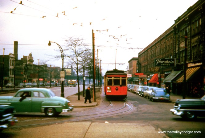 """This picture of CTA 528 was taken in January 1952 on Roosevelt Road near Ashland, where route 9 took a jog from Ashland to Paulina. There was a portion of Ashland where streetcars were not permitted to operate. One of our readers asks, """"Why is there a gauntlet track in the foreground?"""" This is a picture of Roosevelt and Ashland (the north side of the street), where two different tracks converged into one. First, there was the Ashland car line turning onto Roosevelt towards Paulina. The other track would have been for Roosevelt, since at this point the line took a jog, and went off onto a sort of """"service drive"""" on the sides of the street. In general, Roosevelt ran in the main part of the street, except for the section between Ogden and Ashland, which used this arrangement. (This arrangement is no longer used here, and the area where streetcars ran is now covered with grass.) So the two tracks, coming from different directions, could have converged into one at this spot. This is shown on the supervisor's track maps. Lending credence to my theory, you can see the """"L"""" on Paulina in the background."""