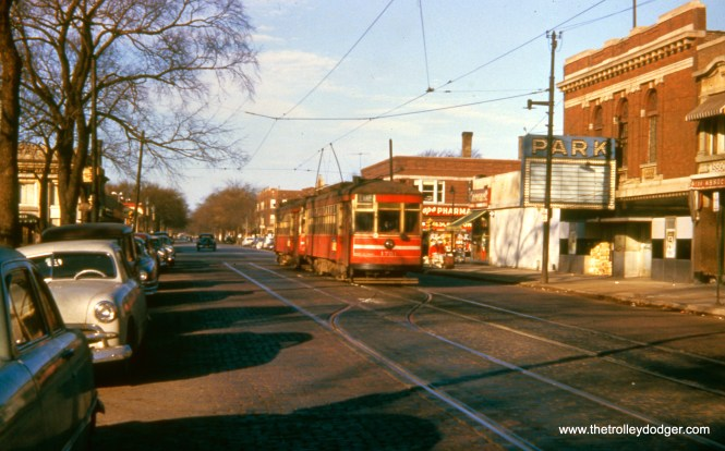 "This view of CTA 1751 looks west from the Chicago side of Lake and Austin in December 1953. The movie theater has closed, and was eventually demolished. Riders heading west from here could take a Chicago & West Towns bus across the street. The Lake Street ""L"", just to the south, continued west for another 1.5 miles."