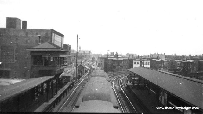 "We are looking east from the Indiana Avenue station. Off in the distance, more or less straight ahead, is the Kenwood branch of the ""L"". The north-south main line heads off to the right (south) at this point, and Stock Yards service would go behind us to the west. M. E. adds: ""The caption also says Stock Yards service is behind the photographer. It would be more accurate to say the Stock Yards L used the south side of the south platform, which is visible in the picture. From there the Stock Yards L headed west (behind the photographer) to Halsted, then into the stock yards. This picture was taken while the Kenwood line was still a through line into the Loop (and possibly north to Wilson). The same view after the Kenwood line was cut back to a shuttle is in photo dave408."" George Trapp adds: ""straight ahead with jog is the Kenwood Branch, which shared embankment with Chicago Junction Ry."" (George Trapp Collection)"