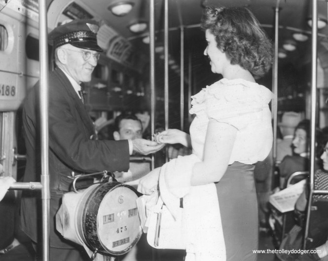 "On August 1, 1951, CTA surface system fares were increased to 17 cents. Here, on two-man PCC 4188, Miss Elma Parrssinen dutifully pays her fare to conductor James Long. According to information provided by Andre Kristopans, which we ran in a previous post, car 4188 had a retirement date of June 9, 1953, making it one of the first postwar cars scrapped as part of the so-called ""PCC Conversion Program,"" whereby some parts from these cars were recycled into new 6000-series ""L"" cars."