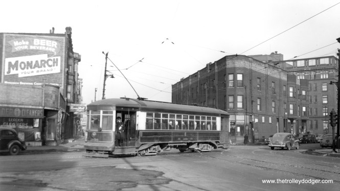 "CSL 1856. Not sure of the exact location, but it appears to be one of Chicago's angle streets. Patrick writes: ""CSL 1856 looks to be eastbound on Harrison (it appears signed for Harrison), crossing Ogden. The building on the northeast corner is still there."" (Joe L. Diaz Photo)"
