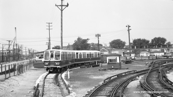 "CTA 2163-2164, then brand new, in the 54th Avenue Yard, west end of the Douglas Park ""L"" (now the Pink Line) in 1964. The roadway at left is where the line continued before it was cut back in 1952. (Walter Broschart Photo)"