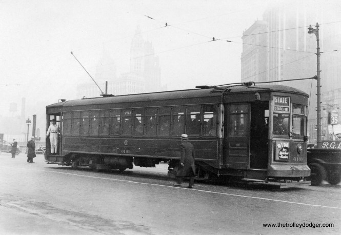"""On a foggy day in December 1932, we see CSL """"maximum traction"""" car 6109 southbound at State and Wacker."""