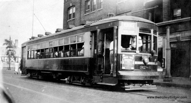 """Caption: """"Chicago Surface Lines #3284. i man car built by Lightweight Noiseless Car Co. in 1925. Taken: Chicago, Ill., 8-4-34. Former two-man (car) also in MU (multiple unit) service. Now equipped with stop light and foot brakes."""" The car is shown at the east end of the Montrose line, just west of Broadway. (Earl W. McLaughlin Photo)"""