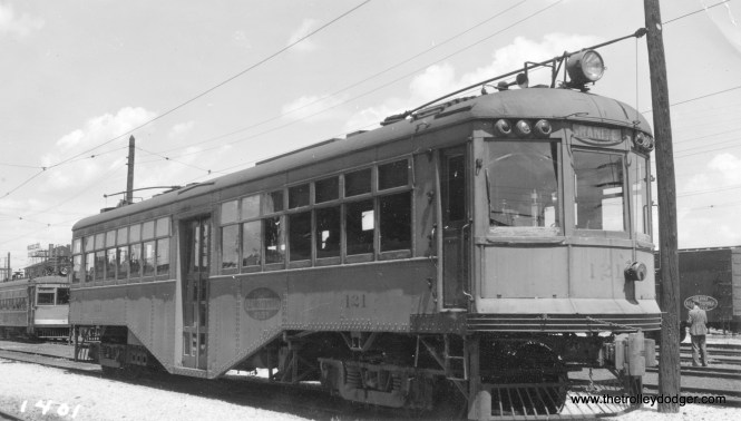 """Illinois Terminal car 121, as it appeared at Granite City on June 7, 1936. It was then being used in local service on the route between St. Louis and Alton. Don's Rail Photos adds, """"121 was built by East St Louis & Suburban in 1924 as 5. It became StL&ARy 5 in 1930 and IT 121 in January 1931. It was sold for scrap to Hyman Michaels Co on July 23, 1953."""" (Glenn Niceley Photo)"""