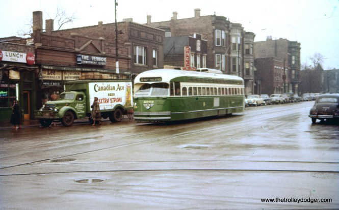 "I have wondered for some time where this picture of CTA 4389 was taken. I had a gut feeling it was somewhere on the south side. Turns out, this is Wentworth and 59th. There is a picture taken at this location on page 217 of CERA B-146. All the buildings on the left are gone now, as this is where the Dan Ryan expressway now runs. As for the date, that truck appears to have a 1955 Illinois license plate. M. E. writes: ""When compared with the photo on p. 217 of B-146, this is indeed 59th and Wentworth. What confuses me is the trackage turning from westbound 59th onto southbound Wentworth. Lind says the 59th St. streetcar line converted to bus in 1948. So my guess is that the CTA wanted to keep trackage open on 59th between Wentworth and State St., and the CTA built the turning trackage at Wentworth after 59th went to bus."""