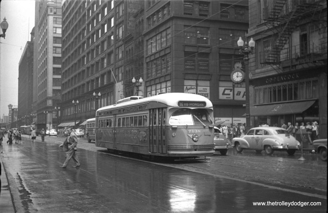 CTA 7238 on State street in the early 1950s. The clock at right belongs to C. D. Peacock jewelers, a Chicago institution since 1837. (Water Hulseweder Photo)