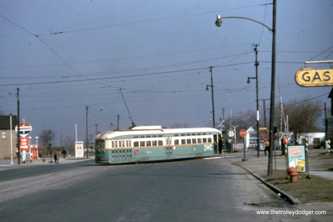This was a tough one to figure out, but my best guess is we are on Halsted looking north just south of 119th. The route 36 PCC 7264 is turning east onto 119th on March 21, 1954, making a jog from 120th. Under the gas sign, you can just barely see a small part of the gateman's tower at this location. Route 8 Halsted PCCs ony ran as far south as 79th.