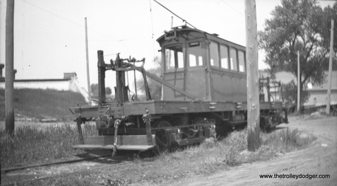 AE&FRE loco 23. The caption gives the location as Aurora, but this may be in error. After passenger service ended in 1935, this line was reduced to three miles of track in the South Elgin area-- the current site of the Fox River Trolley Museum. Electric locos ran unti 1947, and the last freight move took place in 1972. Around 1940, there were a couple of fantrips.