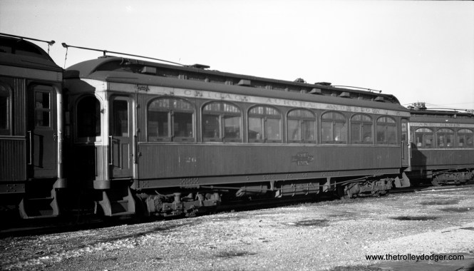 """CA&E wood car 26 in Aurora. Don's Rail Photos notes: """"26 was built by Niles Car in 1902. It was modernized in June 1943 and retired in 1959."""""""