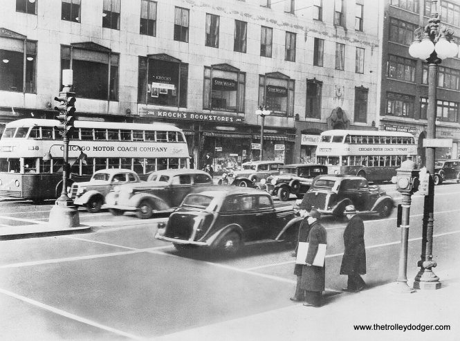 Chicago Motor Coach double-decker buses on Michigan Avenue. Note Kroch's bookstore, which later became Kroch's and Brentano's.