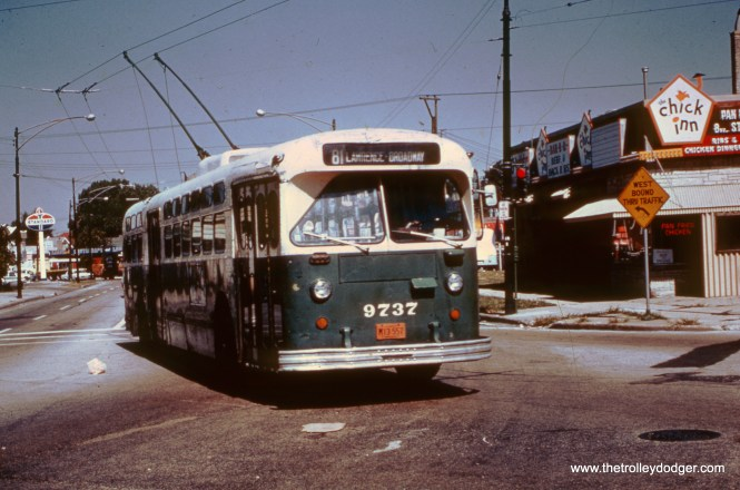 CTA Marmon-Herrington trolley bus 9737 heads east at Lawrence and Austin in August 1969. (Gerald H. Landau Photo)
