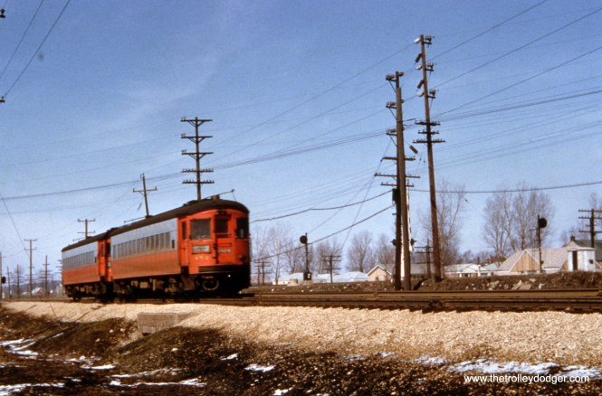 A pair of curved-sided CA&E cars, headed up by 452.
