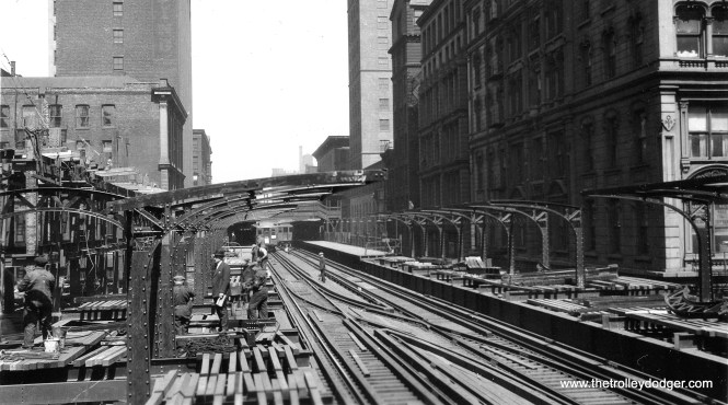 As Loop ridership increased, platforms were extended to create more room to berth trains. Eventually, some stations on the Van Buren and Wells legs of the Loop had continuous platforms connecting them—which may have inspired continuous platforms in Chicago's two first subways. Here, Randolph and Wells is being extended in the early 1920s to connect with Madison and Wells. We are looking north.
