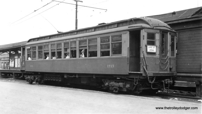 """CRT 1715 at Marion Street in Oak Park on the ground-level portion of the Lake Street """"L"""". It is signed as a local and is about to head east. This car was originally built by St. Louis Car Conpany in 1903 for the Northwestern Elevated Railway as car 715 and was renumbered to 1715 in 1913."""