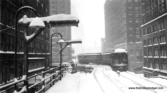 """A snowy scene at Wabash and Lake, site of the tightest curve on the """"L""""."""