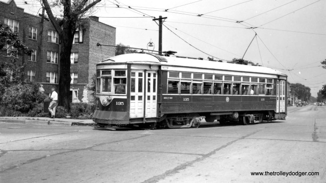 "C&WT 135, making a turn, is signed for Melrose Park, possibly on the Lake or Madison lines. Don's Rail Photos: ""135 was built by McGuire-Cummings in 1919. It was scrapped in 1947."" (Joe L. Diaz Photo) Joe writes: ""The photo of C&WT car 135 is looking east at Madison and 19th in Maywood. The apartment building is still there."" Andre Kristopans: ""CWT 135 turning from W on Madison to N on 19th Ave."""