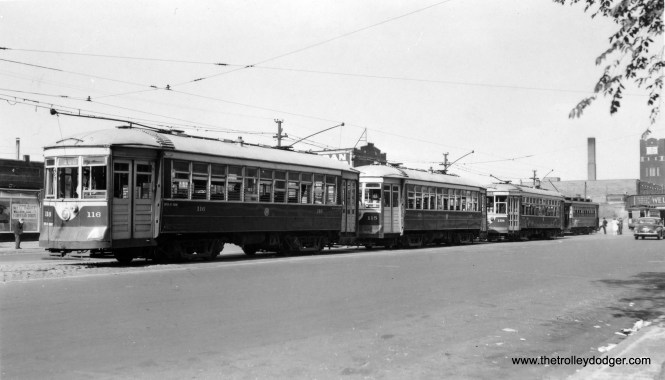 C&WT 116, 115, and 158 at Cermak and Kenton, east end of the LaGrange line. Riders heading east could change here for Chicago Surface Lines route 21 streetcars like the one shown at rear. (Joe L. Diaz Photo)