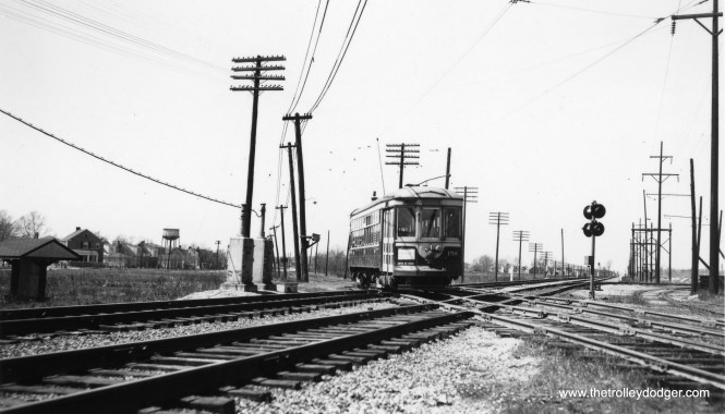 C&WT 158 crossing the Illinois Central at 26th Street in Riverside. I believe the car is heading east. If it was heading west, the sign on the front of the car would probably advertise service direct to the Brookfield Zoo. (Joe L. Diaz Photo)