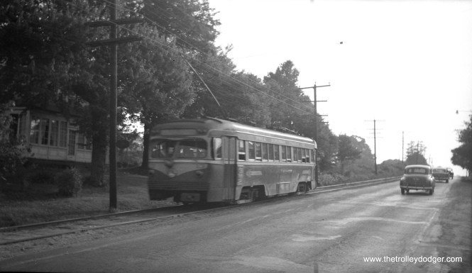 Philadelphia Suburban Transportation Co. (aka Red Arrow) 13, a 1949 product of St. Louis Car Co., in side-of-the-road operation on West Chester Pike, June 2, 1954. Buses replaced trolleys a few days later to allow for the widening of this important thoroughfare.