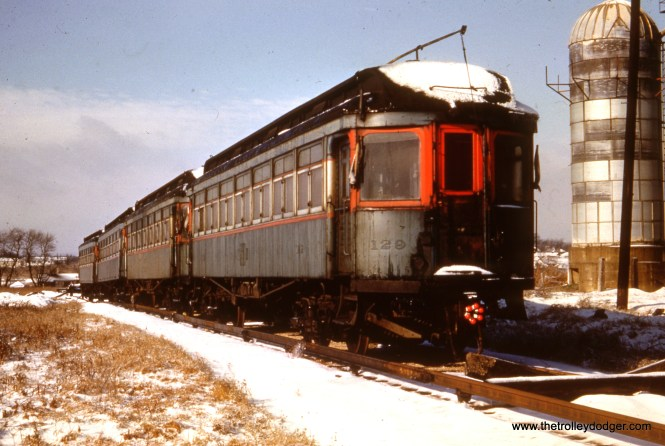 Some ex-North Shore Line woods are in dead storage at the west end of Wheaton Yard, circa 1954, shortly to be scrapped.