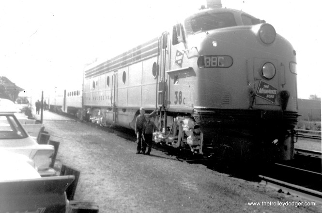 A Milwaukee Road commuter train in July 1961. This is about the time the railroad began introducing bi-levels, which the Chicago & North Western had been using for some years. I'd bet this is the same scene as in the previous picture, but from the other end. The train is on display at a station.
