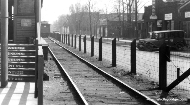 "The view looking east at Lake Street and Ridgeland, when the Lake Street ""L"" ran on the ground. Many years ago, the Rapid Transit Company put advertisements on the steps leading into such ground-level stations. The ""L"" was relocated onto the nearby C&NW embankment in 1962. This picture may be circa 1930."