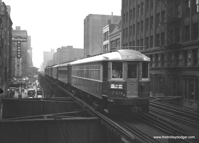 "North Shore Line 719 is northbound on the Loop ""L"" at Adams and Wabash in June 1940."