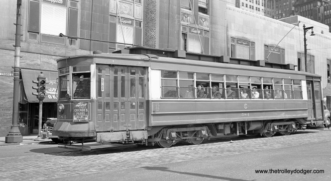 CSL 584, a Milwaukee Avenue car, is at Madison and Canal, in front of the Chicago Daily News building.