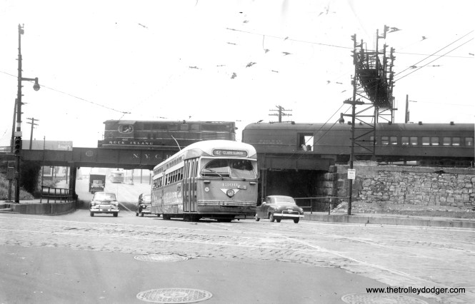 Postwar PCC 4300, heading northbound on Route 42 (which was an offshoot of the Halsted line), has just passed under the New York Central on its way towards Clark and Illinois Streets. That's a Rock Island train passing by, with a Railway Express car.